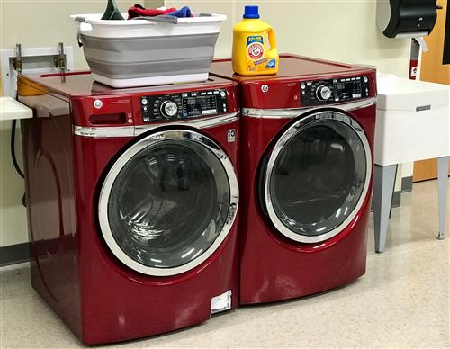 Washer and dryer with laundry basket.