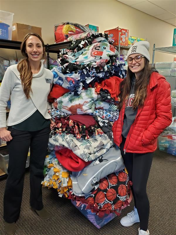 DECA, NHS Team Up to Make Blankets for WeCAN