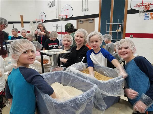 Many Hands Pack Many Meals at Hilltop